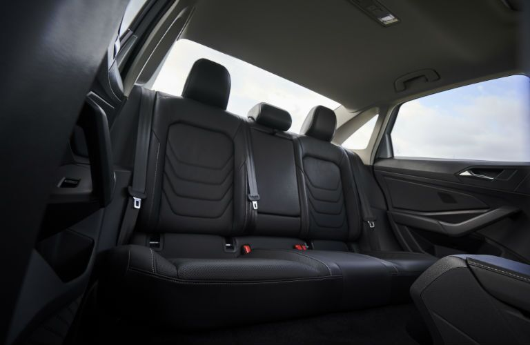 A photo of the rear seats in the 2019 VW Jetta with black upholstery.