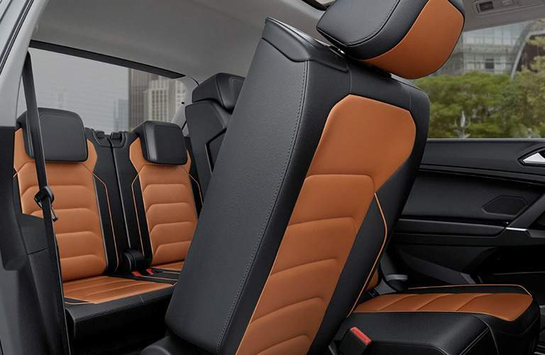 An interior photo of the 2018 Tiguan showing how passengers can get to the third-row of seats