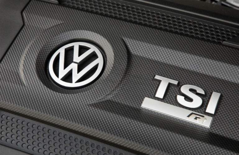 Volkswagen TSI engine with a specific Golf R badge on the cover shows vehicle's great performance
