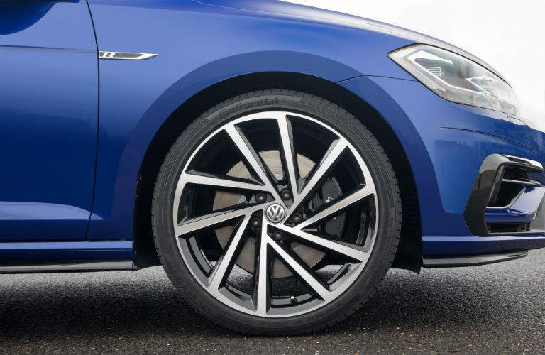 Front passenger side wheel shown. The 2018 Golf R offers available all-wheel-drive