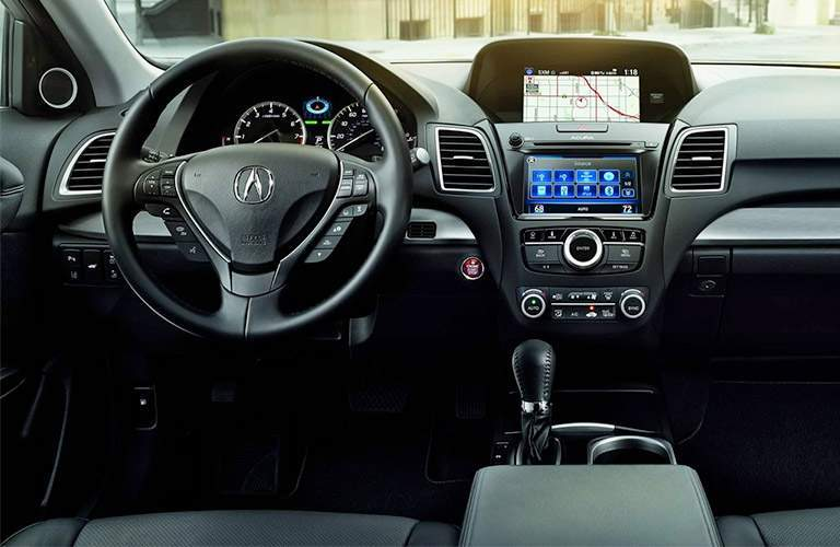 view of steering wheel and touchscreen inside the 2018 Acura RDX
