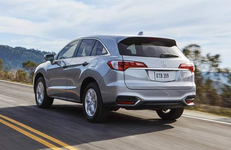 rear view of 2018 Acura RDX on a hillside road