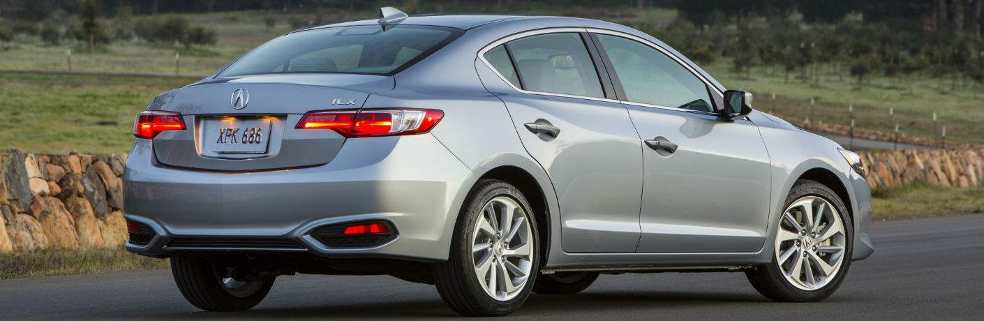 A rear right quarter photo of a 2018 Acura ILX parked in a lot.