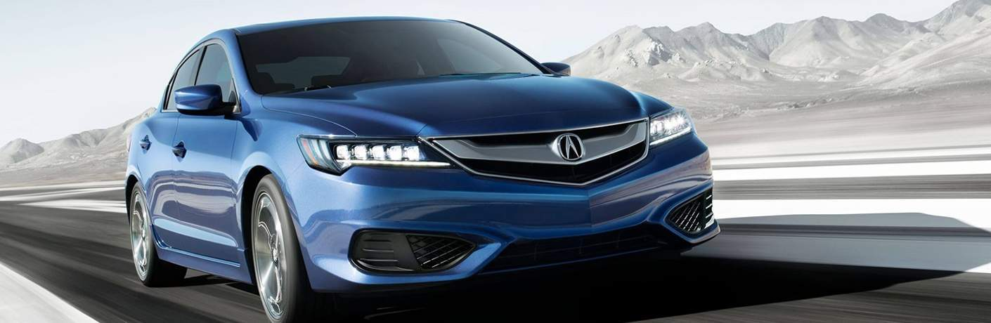 A blue 2018 Acura ILX Special Edition against a black and white background