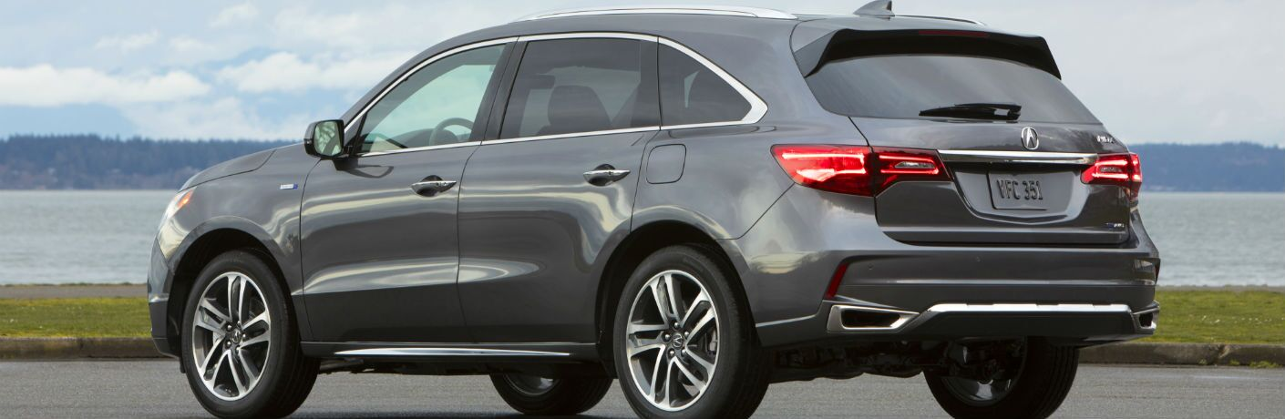 A rear left quarter profile photo of the 2018 Acura MDX Sport Hybrid