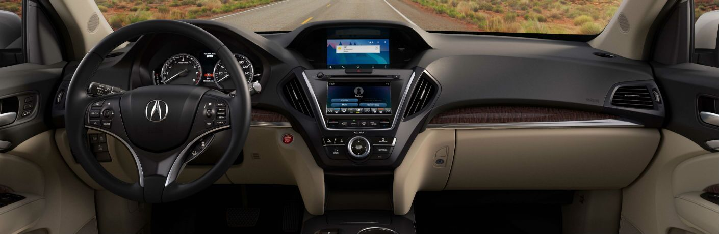 An interior photo of the 2018 Acura MDX showing a wide array of its standard and available technology.