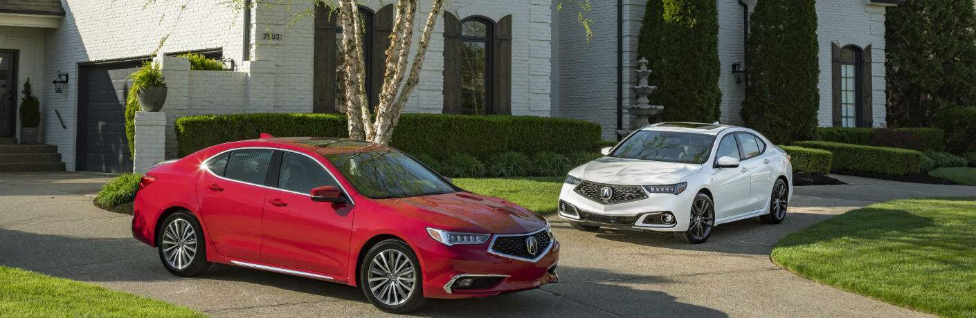 Red and white examples of the 2018 Acura TLX near Pittsburgh, PA in front of a house