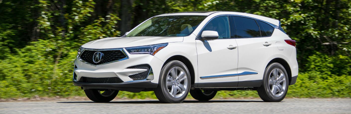 A left profile photo of the 2019 Acura RDX on the road.