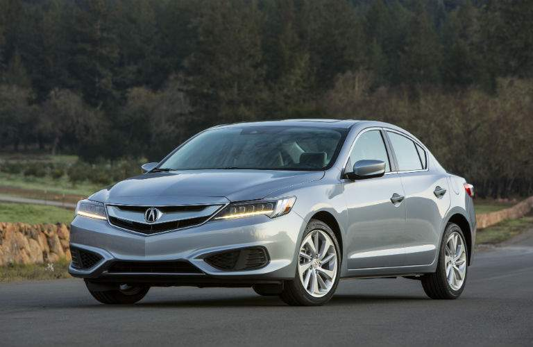 A front left quarter photo of a 2018 Acura ILX parked on a road.