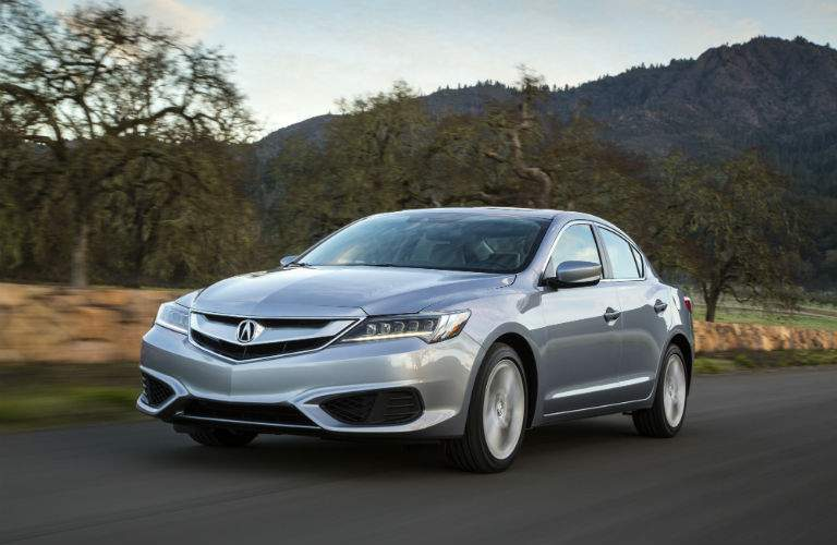 Front quarter view of the 2018 Acura ILX in white on an isolated country road