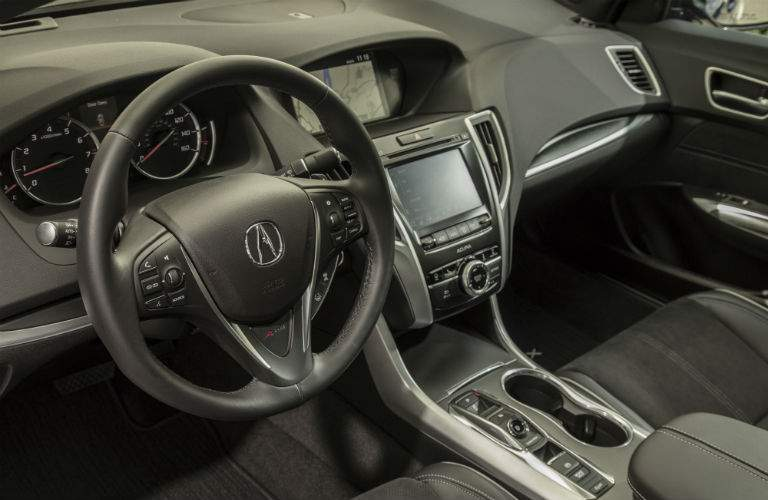 Interior photo of the steering wheel, center gauge cluster and infotainment system of the 2018 Acura TLX