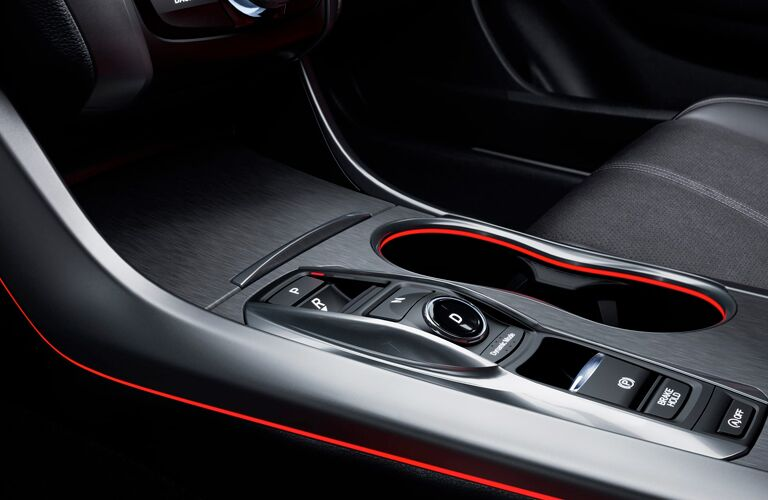 A close up photo of the center console features in the 2018 Acura TLX.
