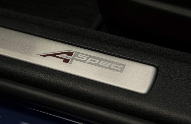 An A-Spec logo is on the door sills of the 2018 TLX A-Spec, available at Spitzer Acura