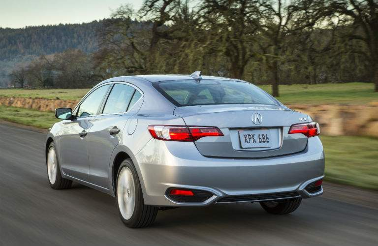 A rear quarter view a gray 2018 Acura ILX