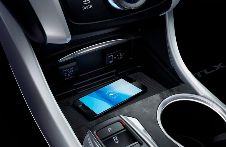A photo of the wireless charging tray in the 2018 Acura TLX.