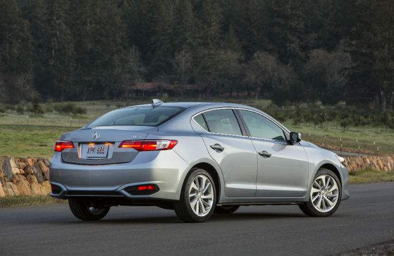A rear quarter view of a gray 2018 Acura ILX parked alone in a parking lot