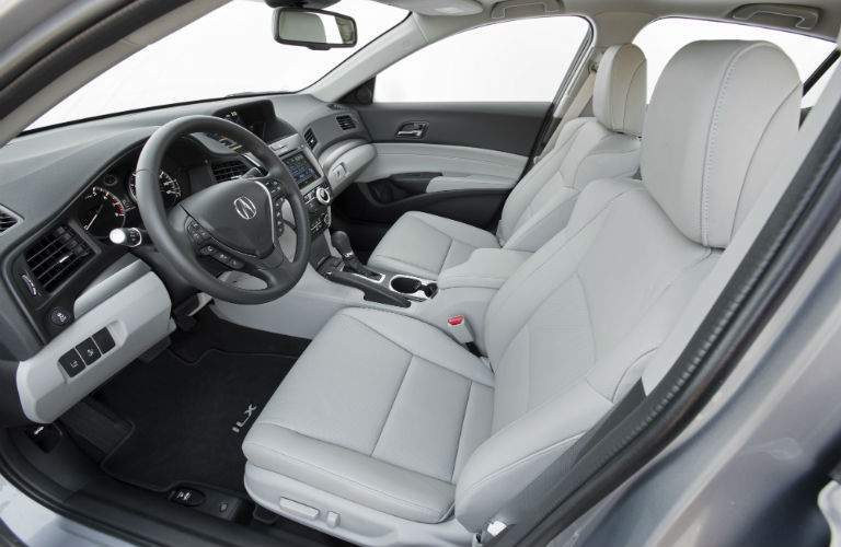 A view from the driver's side door of the front seat of a 2018 ILX with white interior upholstery