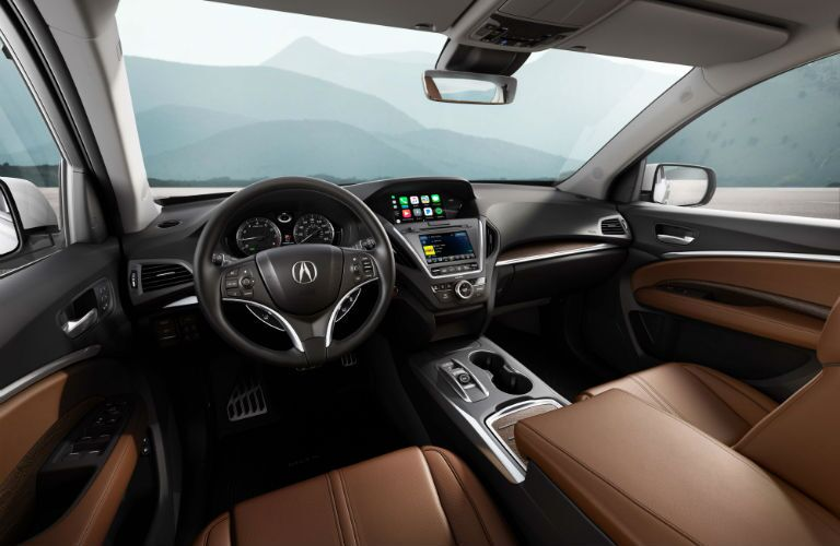 An interior photo of the front portion of the 2018 MDX Sport Hybrid showing the infotainment system.