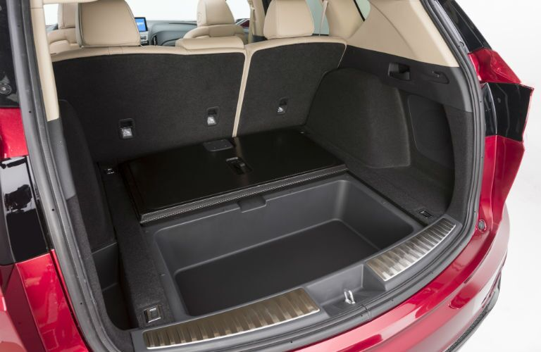 An interior photo showing some rear cargo storage options in the 2019 Acura RDX prototype.