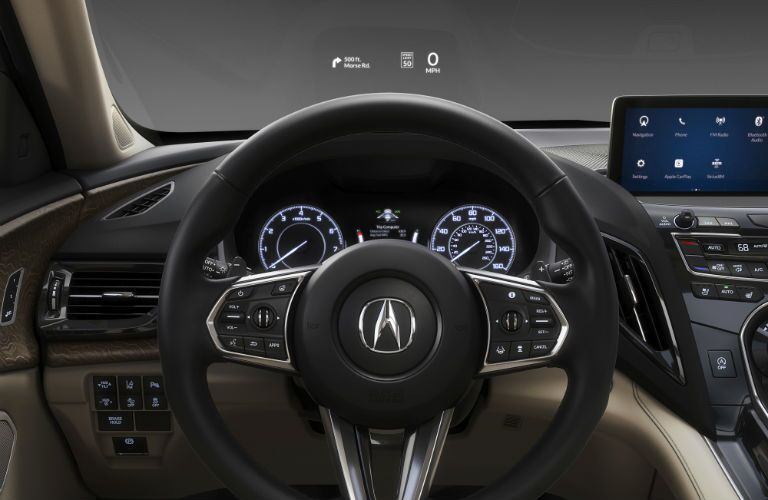 A photo showing the new HUD, infotainment system and center gauge cluster in the 2019 RDX prototype.