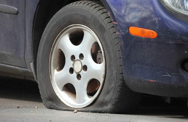 A stock photo of a flat tire representing available Acura roadside assistance