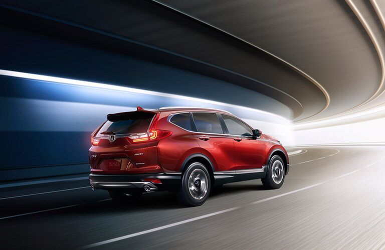 red 2017 Honda CR-V driving through a tunnel