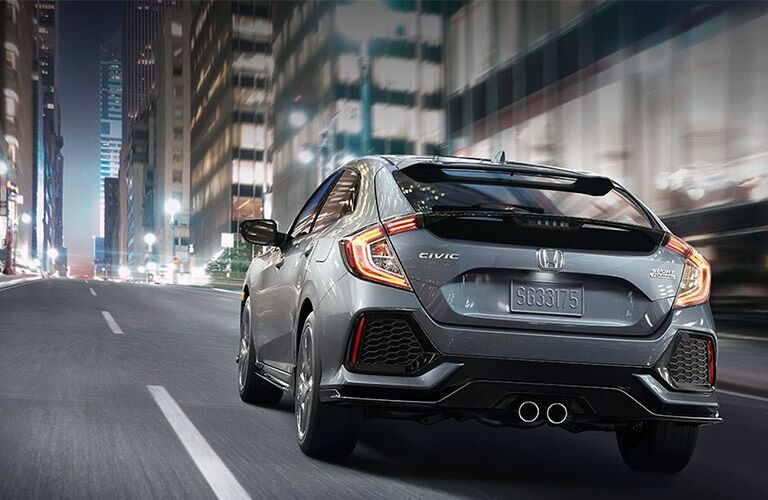 rear of the 2017 Honda Civic Hatchback driving through city at night