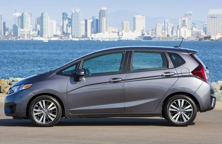 2017 Honda Fit parked beside water body and city