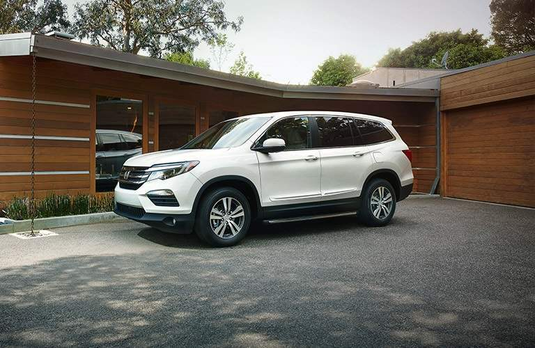 white 2017 Honda Pilot parked in driveway
