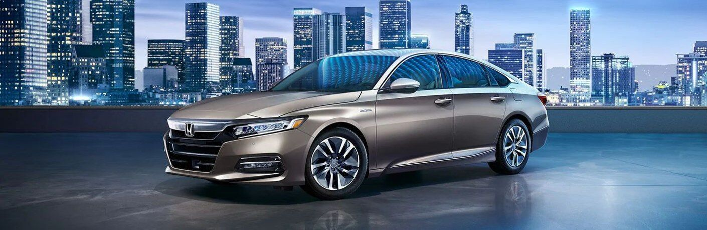 2020 Honda Accord Touring Hybrid parked in front of cityscape