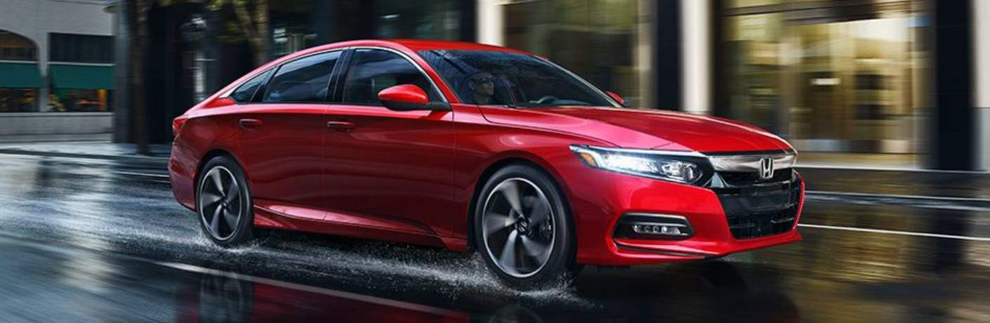 red 2018 Honda Accord driving through wet road