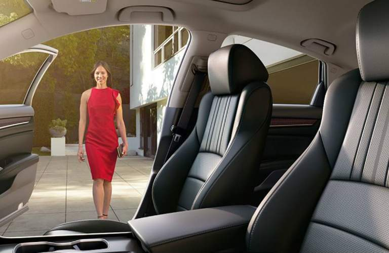 Dressed-up woman walking to 2018 Honda Accord