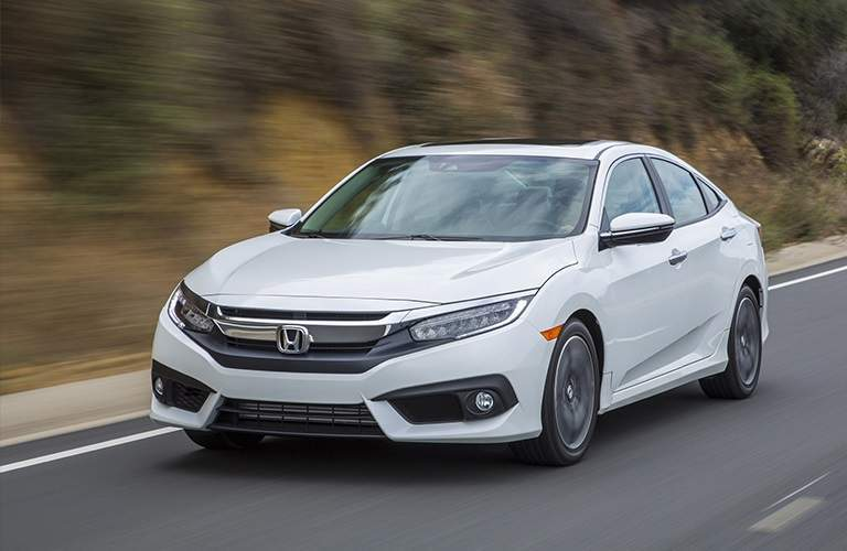 white 2018 Honda Civic driving on open road