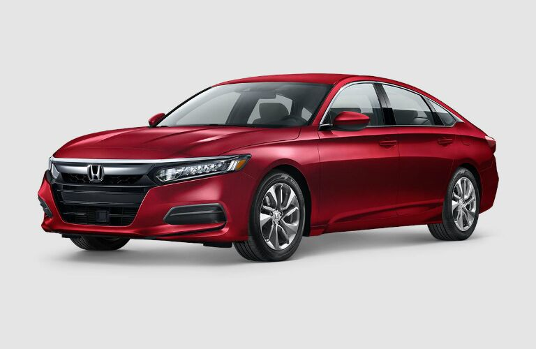 Front-side view of a red 2018 Honda Accord on a grey background