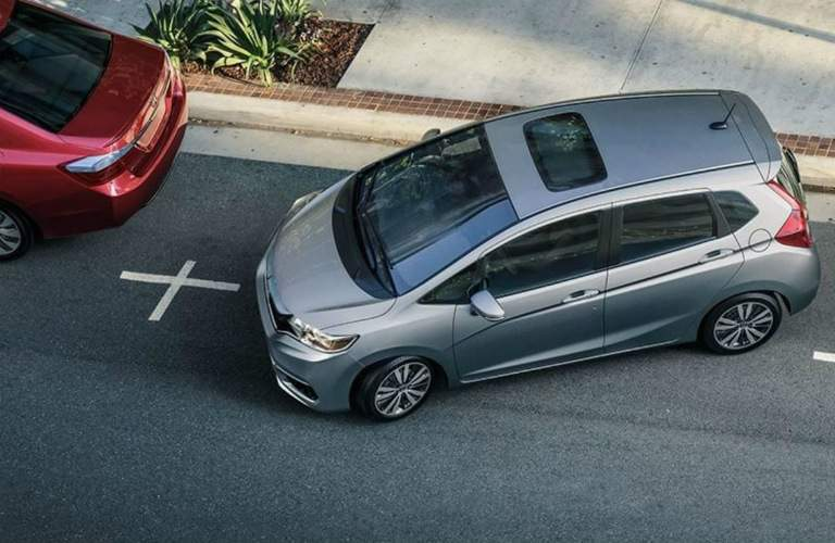 grey 2018 Honda Fit parallel parking