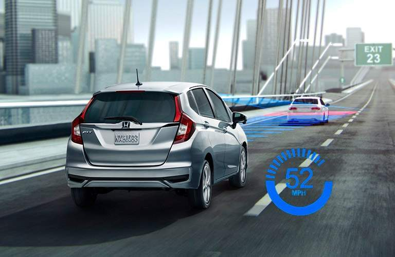 2018 Honda Fit driving over bridge