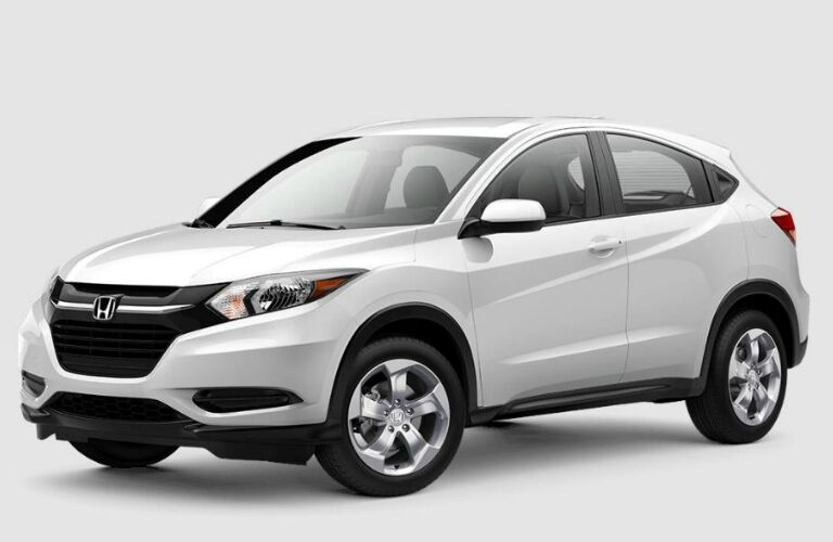 front-side view of a white 2018 Honda HR-V on a grey background