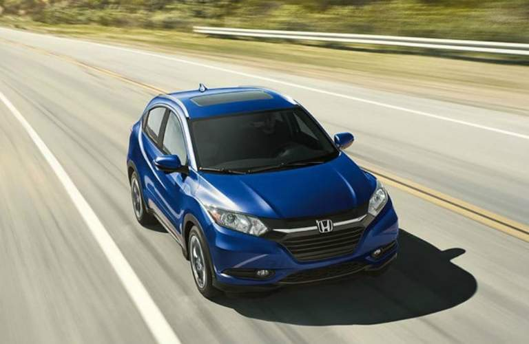 blue 2018 Honda HR-V driving on open road
