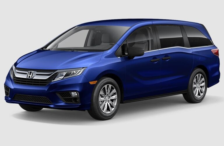 Blue 2018 Honda Odyssey on a grey background