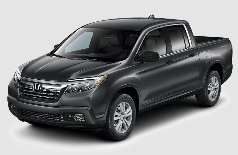 Black 2018 Honda Ridgeline on a gray background