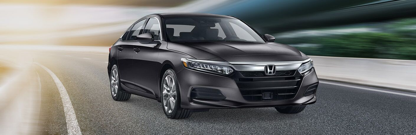 Dark grey 2019 Honda Accord drives down a highway in a stylized, cel-shaded photo.