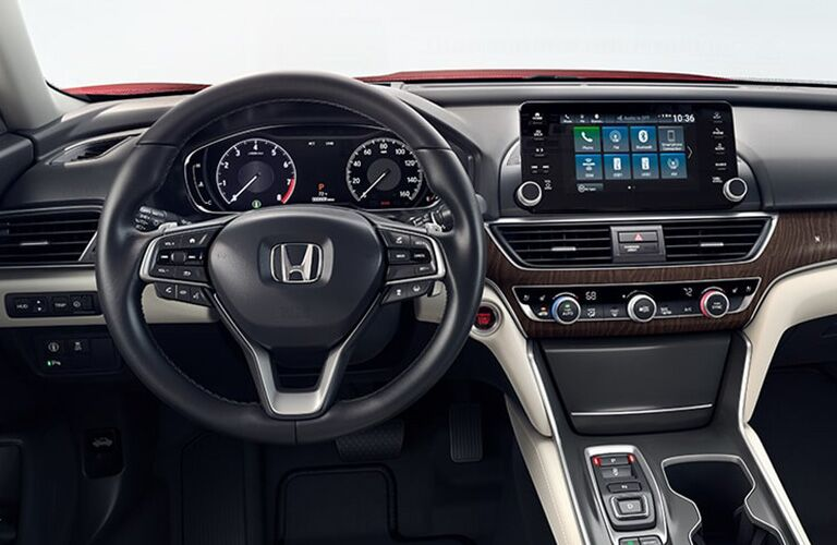 Interior steering wheel, dash, and infotainment system within the cabin of a 2019 Honda Accord.