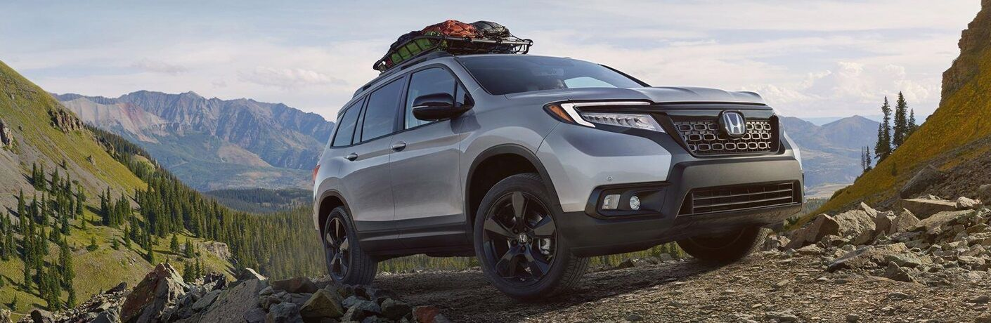 2019 Honda Passport driving through mountain trail