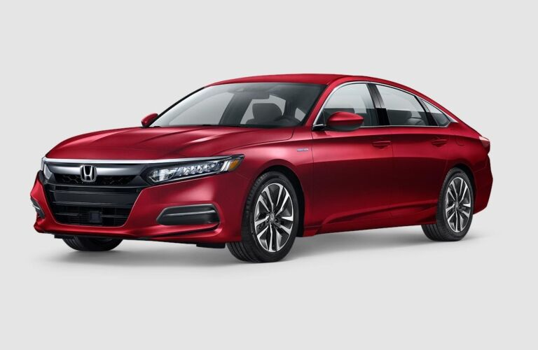 Red 2019 Honda Accord Hybrid on a gray background