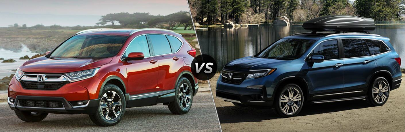 Red 2019 Honda CR-V and blue 2019 Honda Pilot side by side