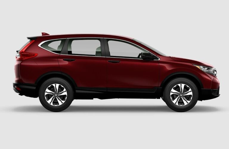 Side view of a red 2019 Honda CR-V on a gray background