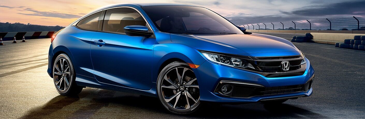 Blue 2019 Honda Civic Coupe on test track