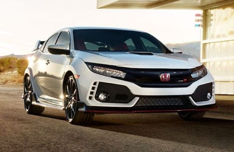 2019 Honda Civic Type R parked in front of garage