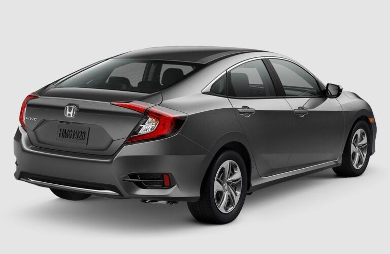 Rear side view of a 2019 Honda Civic on a gray background