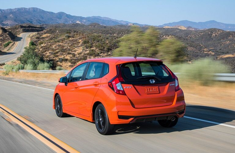 Rear view of an orange 2019 Honda Fit